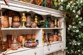 white sideboard with traditional handmade objects