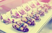 Canapes with cured ham on banquet table, selective focus, toned image