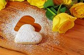 picture of yellow rose  - Background with baked sweet hearts and yellow roses - Valentine