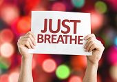 Just Breathe card with colorful background with defocused lights