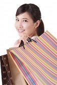 Asian lady holding colorful shopping bag, closeup portrait.