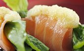 picture of rocket salad  - A close up of raw salmon sushi dish with rocket salad - JPG