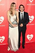 LOS ANGELES - FEB 6:  Sola Harrison, Dhani Harrison at the MusiCares 2015 Person Of The Year Gala at a Los Angeles Convention Center on February 6, 2015 in Los Angeles, CA