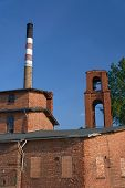 The chimney in old, brick distillery