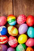 Group of creative Easter symbols on wooden background