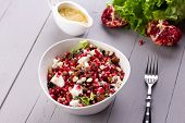 Healthy Salad With Pomegranate Seeds, Almond, Feta Cheese And Black Rice