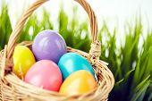 Easter eggs of various colors in basket