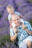 Happy Dad With Baby Son In Lavender