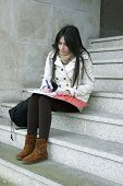 stock photo of academia  - university outdoors lifestyle of young students - JPG