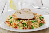 couscous with green peas and chicken fillet grill