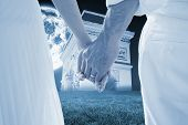 Bride and groom holding hands close up against bright moon over arc de triomph