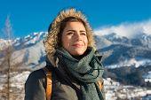 Portrait of cute smiling woman posing against nature