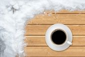Top view of cup coffee with snow