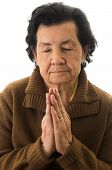 stock photo of grandmother  - closeup shot of grandmother praying isolated on white - JPG