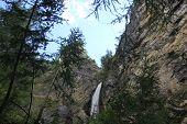 Waterfall Through Rocks In Madesimo