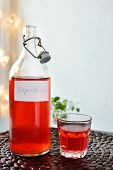 Lingonberry drink in a bottle and in a cup