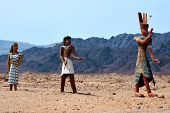 stock photo of israel people  - Figures of ancient Egyptian people at the entrance to Timna National park Israel - JPG