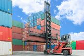 picture of weight lifter  - Crane lifter handling container box loading to depot - JPG