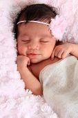 Beautiful smiling newborn baby girl.
