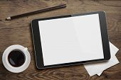 stock photo of cup coffee  - Tablet pc like ipad on table desk with coffee cup and pencil - JPG