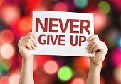 Never Give Up card with colorful background with defocused lights