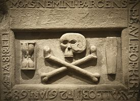 foto of skull cross bones  - Skull and cross bones with latin text in a tomb - JPG
