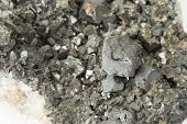 foto of ore lead  - Closeup macro picture of black lead ore irregular texture with mineral parts - JPG