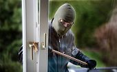 stock photo of judiciary  - A burglar at a window of a house - JPG