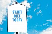 picture of start over  - Start Diet Today motivational quote written on white road sign isolated over clear blue sky background - JPG