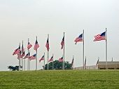 pic of washington monument  - Flags of the United States waving in the wind around the Washington Monument in Washington D.C. ** Note: Visible grain at 100%, best at smaller sizes - JPG