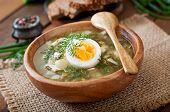 foto of sorrel  - Green soup of sorrel in wooden  bowl - JPG