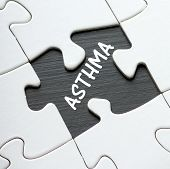 picture of asthma  - The word Asthma revealed on a blackboard by a missing piece in a jigsaw puzzle - JPG