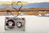 foto of heart sounds  - Audio cassette with magnetic tape in shape of heart on wooden background - JPG