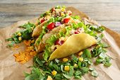 foto of tacos  - Tasty taco with greens on paper close up - JPG