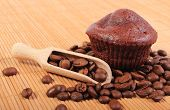 image of chocolate spoon  - Homemade delicious fresh baked chocolate muffins and heap of coffee grains with wooden spoon lying on wooden background concept for dessert - JPG