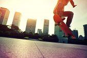 foto of skateboard  - closeup of skateboarder skateboarding at sunrise city - JPG