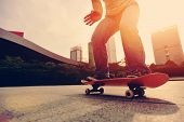 picture of skateboard  - closeup of skateboarder skateboarding at sunrise city - JPG