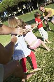 stock photo of tug-of-war  - Fathers And Children Playing Tug Of War - JPG