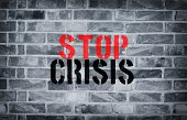 stock photo of isis  - Stop Crisis stencil print on the grunge white brick wall - JPG