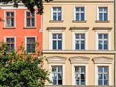 stock photo of tenement  - Facades of ancient tenements in the Old Town in Krakow Poland - JPG