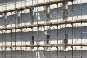 image of scaffold  - Against a white house wall there is a scaffold - JPG