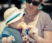 stock photo of obese children  - eating unhealthy food at the beach with the family - JPG