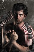 image of uncle  - Stylized Uncle Sam fighter holding American Flags as claws - JPG