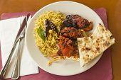 image of tamarind  - Indian tandoori chicken with fresh naan and tamarind rice - JPG