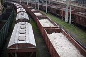 stock photo of railroad yard  - rail cars cargo loaded - JPG