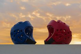 picture of taekwondo  - Red and Blue Taekwondo head guard with on sunset background - JPG