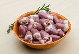 picture of giblets  - Raw chicken hearts with thyme and rosemary  - JPG