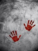 bloody hand print on cement wall