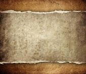 grunge paper on leather background