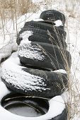 Old Tire In Snow Covered Yard